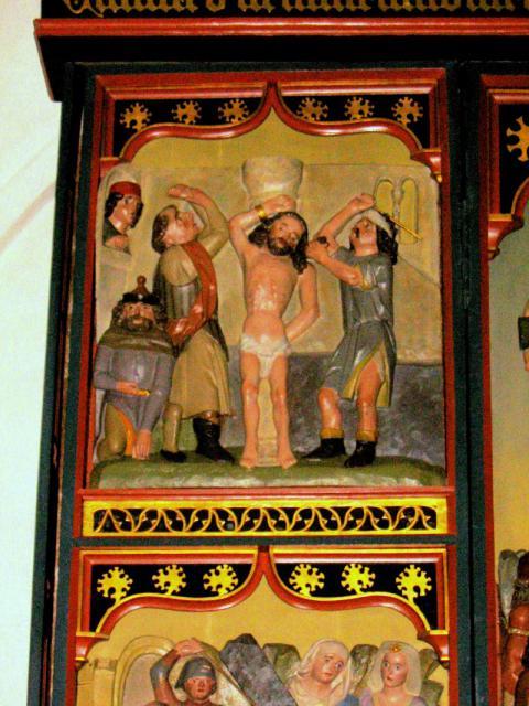 Hudstrygning -detalje altertavle (1470) Skårup kirke